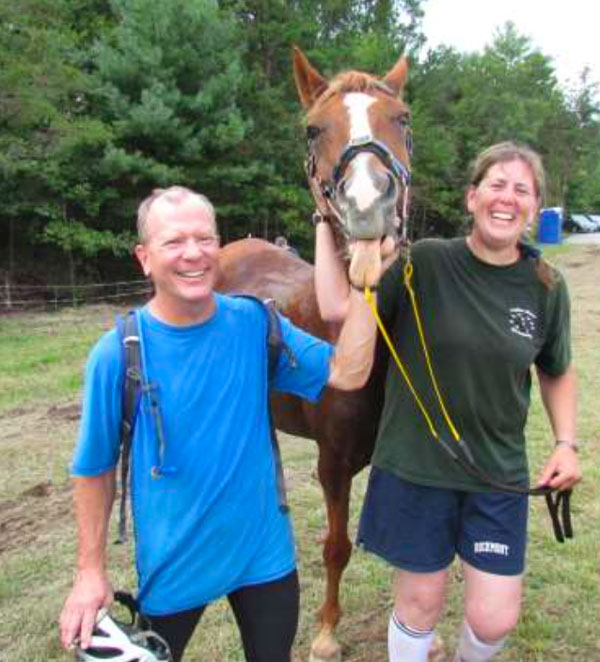 Photo of two Ride & Tie riders and a horse.