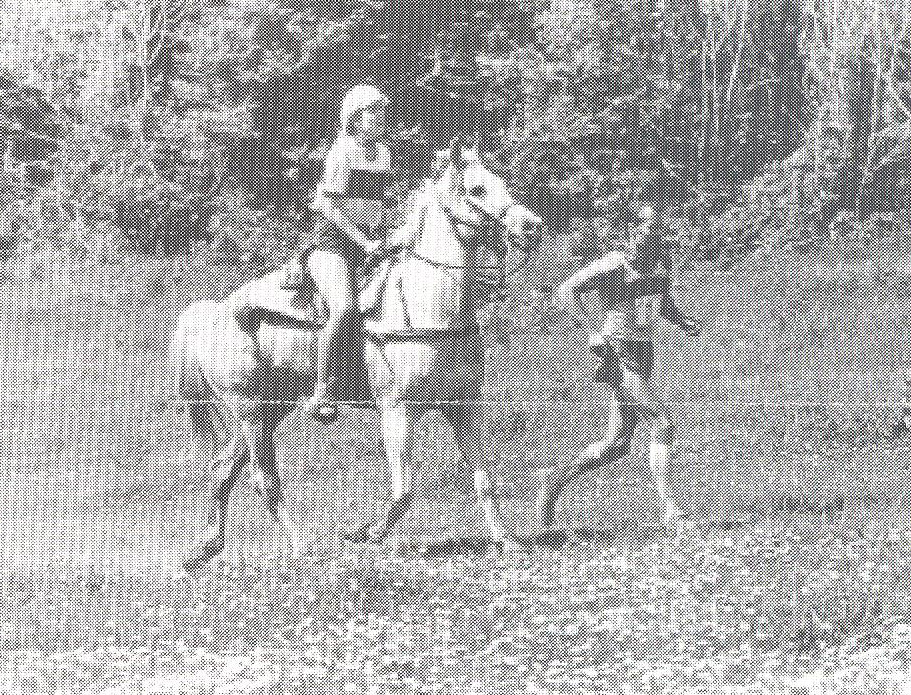 Old image of a horse and rider.